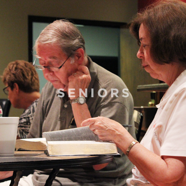 Church on the Rock Seniors Ministry: a married couple reading their Bibles together